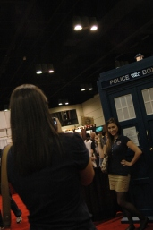 Attendees posing with replica Tardis