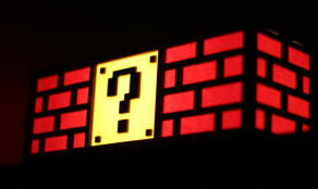 http://www.etsy.com/listing/90085886/colorful-mario-question-mark-block-lamp