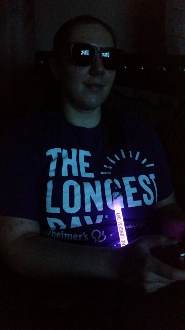 Theresa playing games against the purple glow of the glowstick